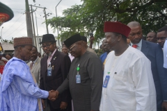 The-Honorable-Minister-on-his-arrival-in-a-handshake-with-the-Director-Press-Mr.-Charles-Nwodo.