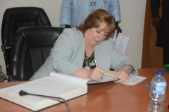 Catherine Gibbons head of delegation signing the Perm Secs register