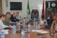 Catherine Gibbons of the US Mission in Nigeria addressing the Perm Sec MOD while others listen